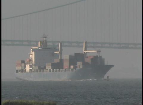 A cargo ship passes under the Manhattan Bridge Footage