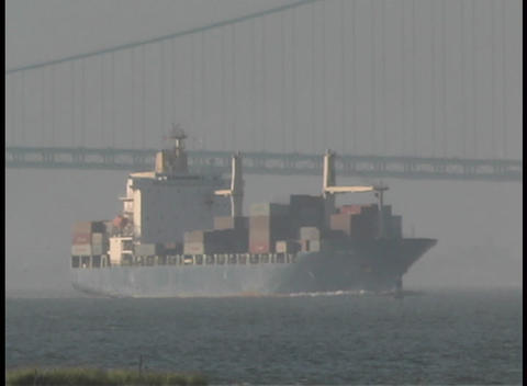 A cargo ship passes under the Manhattan Bridge Stock Video Footage