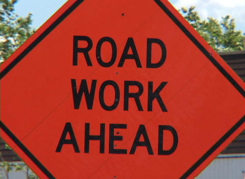 A red road work sign Stock Video Footage