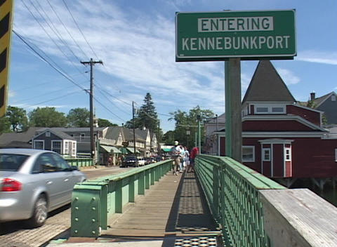 Pedestrians stroll across the bridge to Kennebunkport, Maine Footage