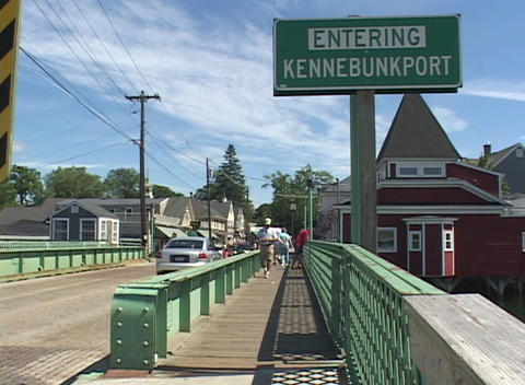 Pedestrians stroll across the bridge to Kennebunkport, Maine Stock Video Footage
