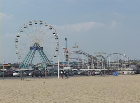 Medium shot of amusement park and fairgrounds at Atlantic... Stock Video Footage