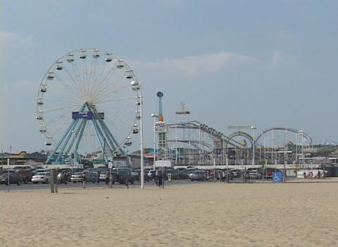 Medium shot of amusement park and fairgrounds at Atlantic City, New Jersey Live Action