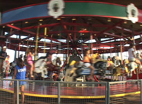 A medium shot of a merry-go-round in motion Stock Video Footage