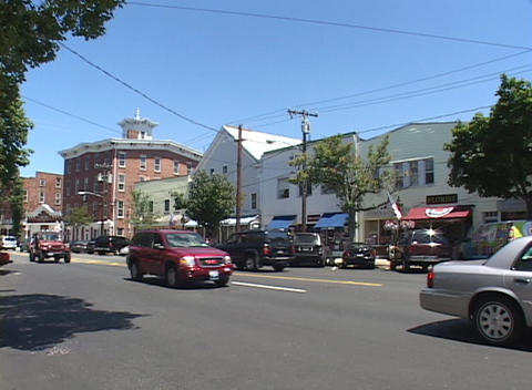 Long-shot of a street scene in Bath, Maine Stock Video Footage