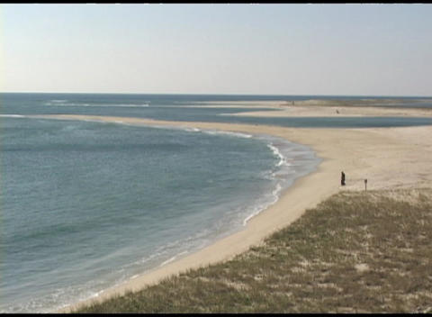 A long-shot high angle view of the shore at Cape Cod, Massachusetts Footage