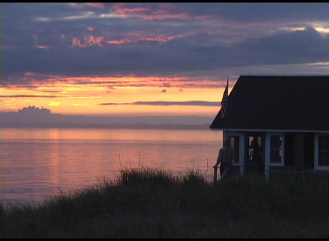 Long-shot of the golden-hour on Cape Cod with house and... Stock Video Footage