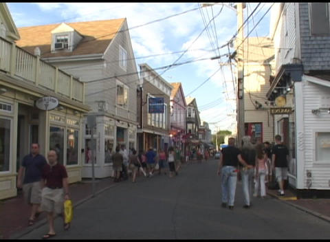 Medium shot of tourists walking on a street in Nantucket, Cape Cod Footage