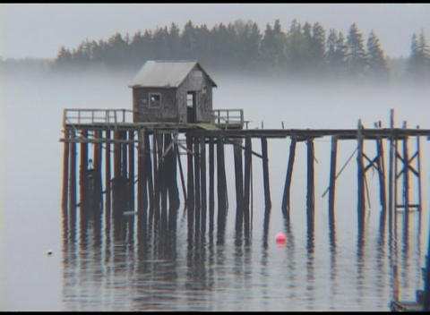 Medium shot of early morning fog over a pier at Jonesport, Maine Footage