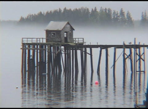 Medium shot of early morning fog over a pier at... Stock Video Footage
