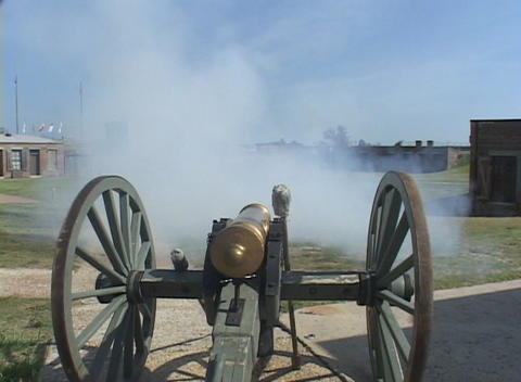 A man fires a cannon at a historic fort Stock Video Footage