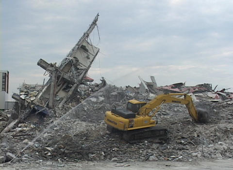 A bulldozer works on building rubble after Hurricane Katrina Stock Video Footage