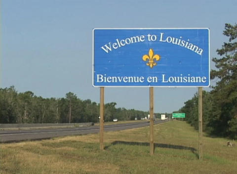 A highway sign welcomes visitors to Louisiana Stock Video Footage