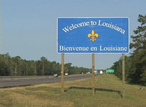 A highway sign welcomes visitors to Louisiana Footage
