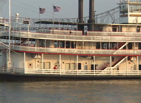 A paddle-boat steamer crosses the Mississippi River with New Orleans in the background Footage