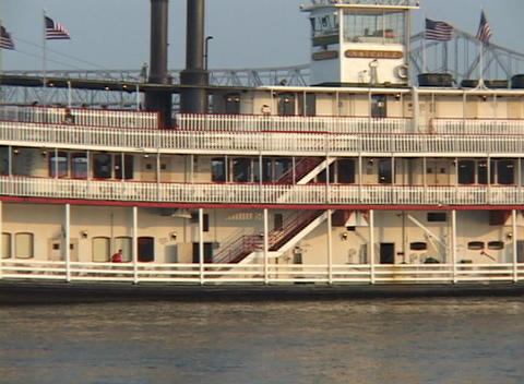 A paddle-boat steamer crosses the Mississippi River with... Stock Video Footage