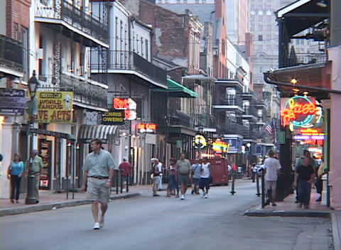 Pedestrians walk in the French Quarter of New Orleans Footage