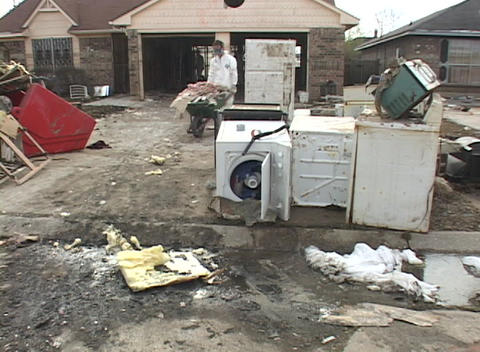 Workers clean out flooded homes following Hurricane Katrina Stock Video Footage