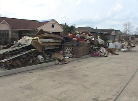 Soaked and destroyed possessions litter a neighborhood... Stock Video Footage