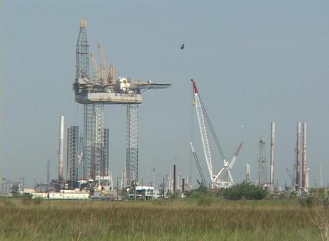 An oil platform under construction along the Gulf Coast Stock Video Footage