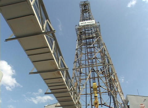 An oil derrick stands in the sun Stock Video Footage