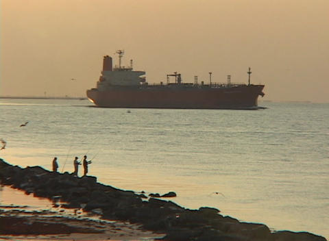 An oil tanker passes along the coastline Stock Video Footage