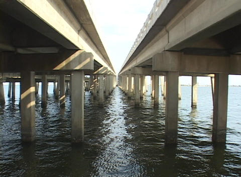 Water moves under two bridges Stock Video Footage