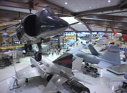 Airplanes and jets line the floor of an airplane museum Stock Video Footage