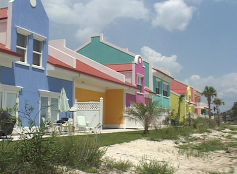Multi-colored houses stand near a beach Stock Video Footage