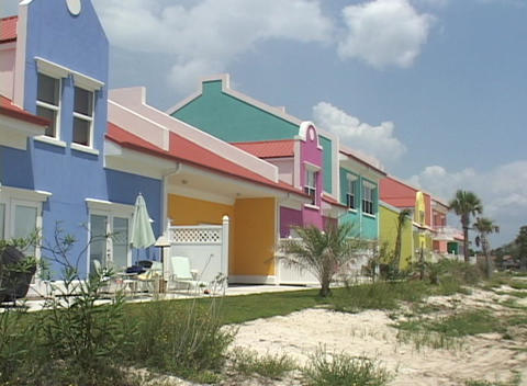 Multi-colored houses stand near a beach Footage