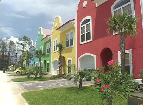 Palm trees wave in the breeze near beach houses Stock Video Footage