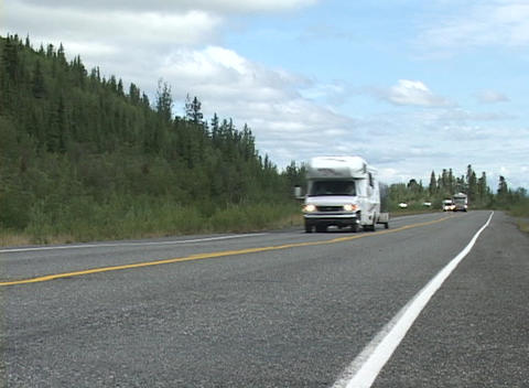 A line of motor homes passing on a paved road Stock Video Footage