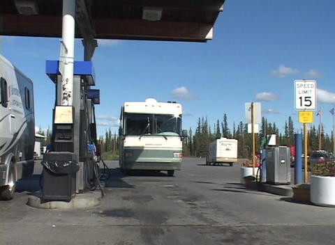A motor home pulls into a gas station Stock Video Footage