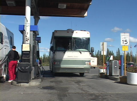 A motor home pulls into a gas station Footage