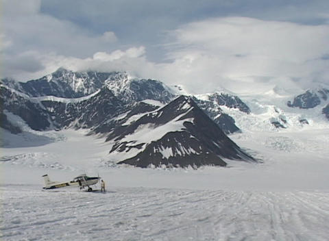 Wide shot of a ski plane on a glacier Stock Video Footage