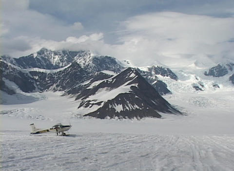 Wide shot of a ski plane on a glacier Footage