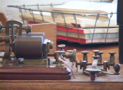 An old telegraph machine sits on a desk Stock Video Footage