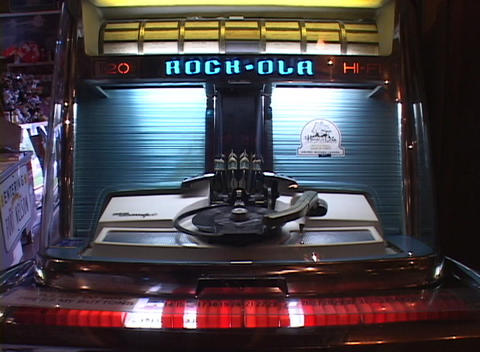 A 45 rpm record is played on an old fashioned jukebox Footage