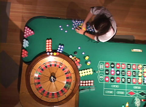 A spinning roulette wheel as seen from above Stock Video Footage