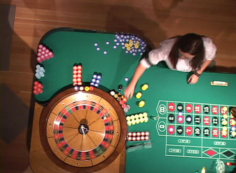A spinning roulette wheel as seen from above Footage