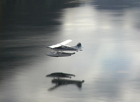 A small plane flies through clouds in a remote part of... Stock Video Footage
