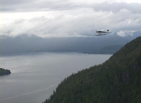 An aerial of a float plane flying over Alaska Stock Video Footage