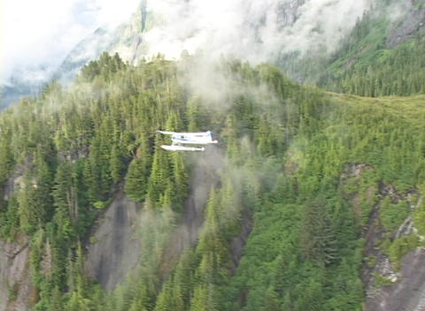 An aerial of a float plane flying over Alaska Footage
