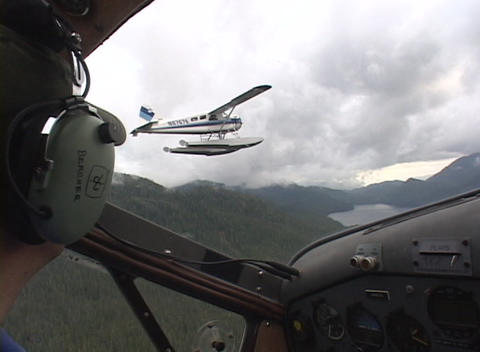 A float plane as seen from the cockpit of another plane Footage