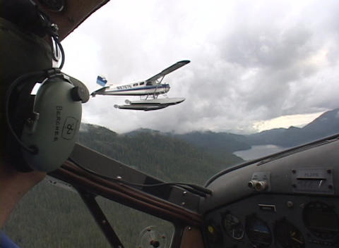 A float plane as seen from the cockpit of another plane Stock Video Footage