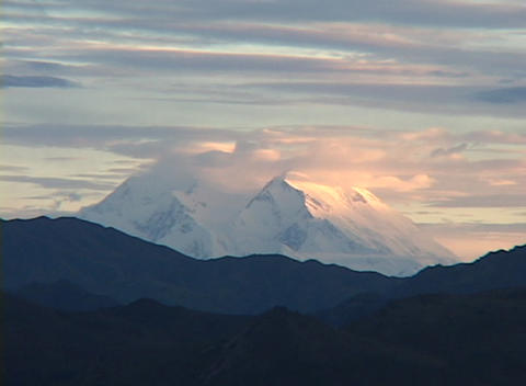 Mt. McKinley in Denali National Park, Alaska in clouds at sunset Footage
