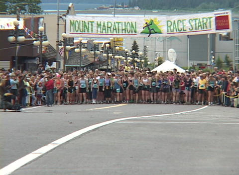 Runners leave the starting line in a marathon Stock Video Footage
