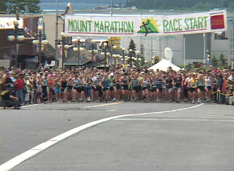 Runners leave the starting line in a marathon Footage