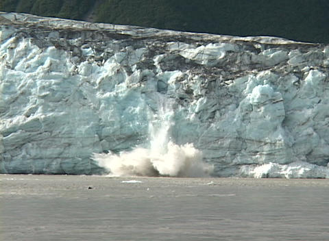 A glacier calves into the ocean Stock Video Footage
