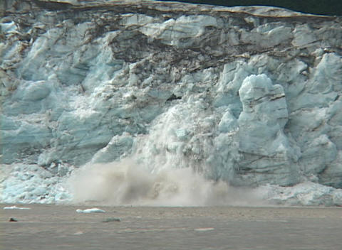 A glacier calves into the ocean Footage